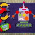 Build-a-robot quiet book page. And - you won't believe this - the robot LIGHTS UP. Incredible.