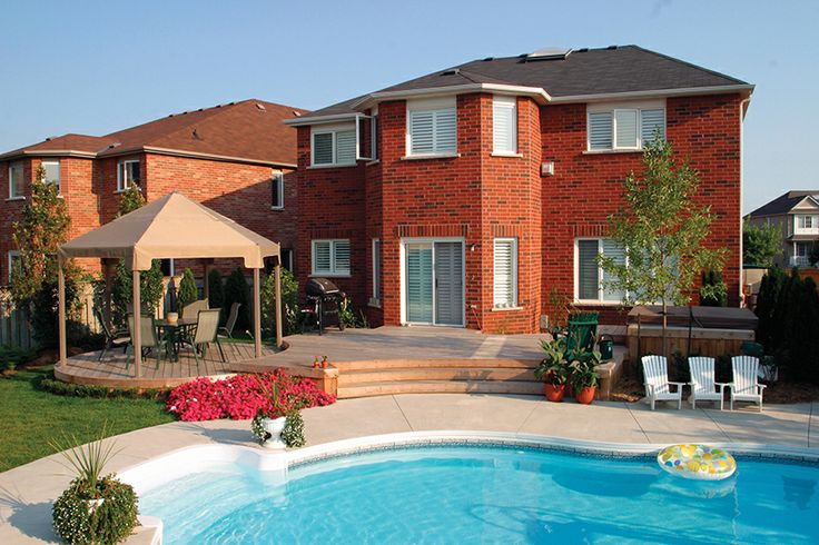 This cedar deck is in Oakville Ontario . It has one deck that is round.