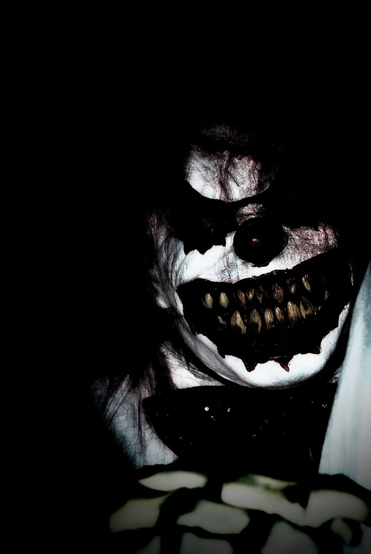 Clowns trace their history through Italian comedic stock characters like Harlequin and Hellequin.  In their original medieval context, these were emissaries of the Devil, clad in black and red, who led groups of demons in chasing the souls of the damned to Hell.  (Photo: Scary Clown by ~TanyaBeth on deviantART)