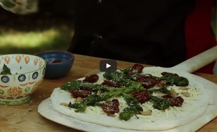 How to make a Broccoli Rabe and sausage pizza  in the backyard oven #pizza #brick #oven #backyard #wood #dough #recipe