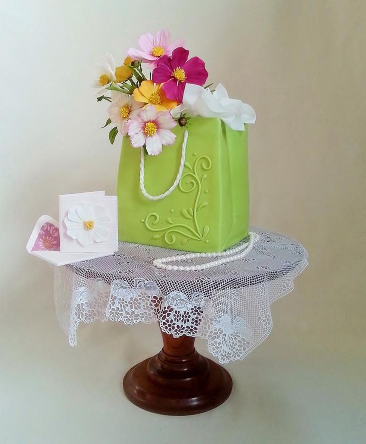 EDITOR'S CHOICE (05/14/2014) Gift Bag Cake by Jeanne Winslow View details here: http://cakesdecor.com/cakes/132717-gift-bag-cake
