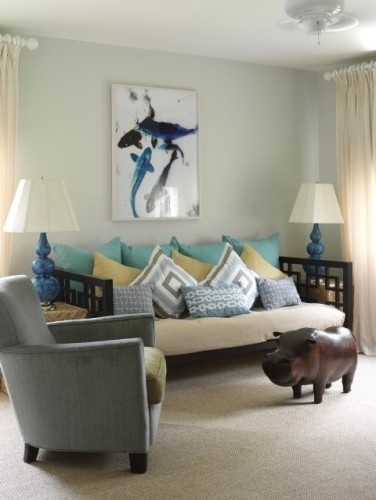 This designer has thrown in some unexpected shades of blue as well as a greenish-yellow into her coastal palette. She's also included an unexpected daybed and a leather hippo.