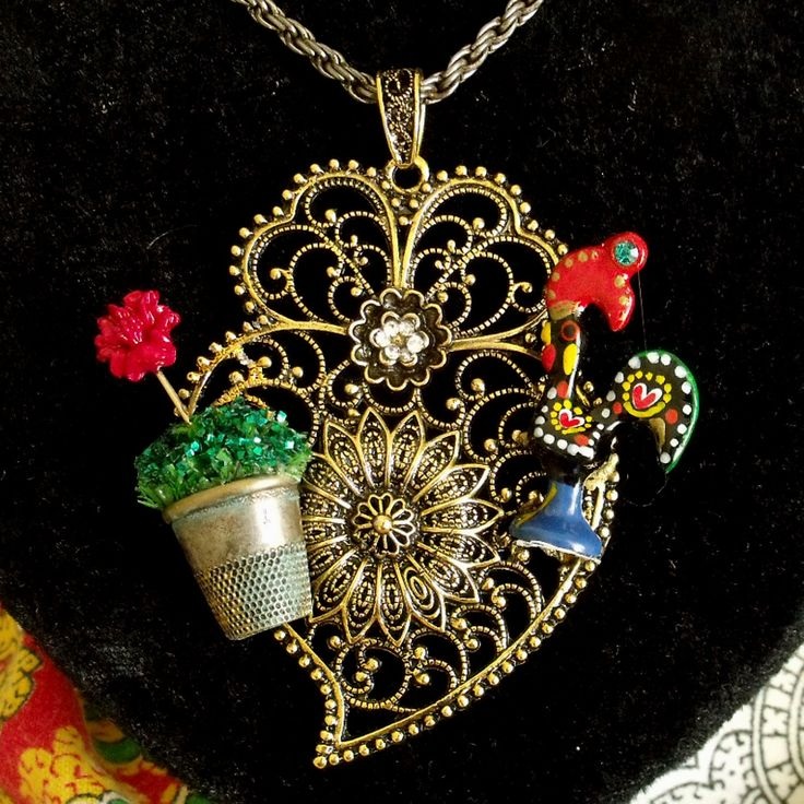 Portuguese inspired folk jewelry necklace heart Coração de Viana pendant made by me using vintage and newer jewelry parts. Filigree, Galo de Barcelos (rooster), Heart of Viana pendant and a vase of Manjerico (basil) are highly popular Portuguese symbols.  . .....$#portuguese jewelry#portuguese filigree jewelry#galo de barcelos#coração do minho#portuguese heart of viana necklace#portuguese rooster#portuguese folk jewelry