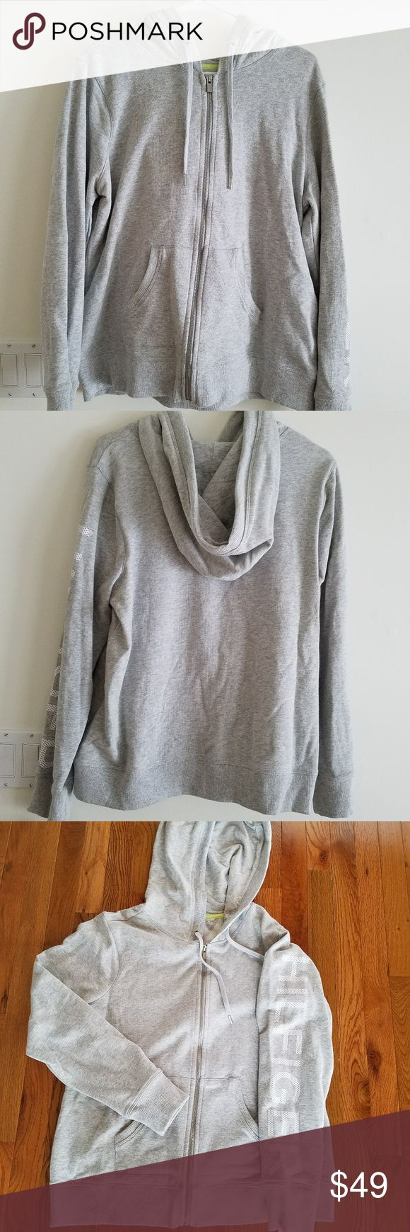 Tommy Hilfiger Sport Women's Hoodie, XL Tommy Hilfiger Sport Women's Hoodie, Brand New with tags attached, never been worn. Light grey, size XL. Zip-up front, two open hand pockets, hood with adjustable strings. All solid grey except one sleeve has Hilfiger written in white block letters. 100% cotton. Comfy and cozy! Make an offer! Tommy Hilfiger Tops Sweatshirts & Hoodies