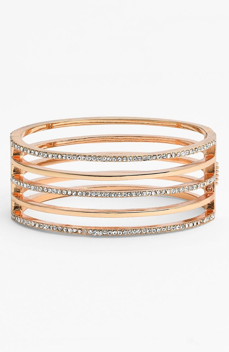 This gold bangle has just the right amount of sparkle.