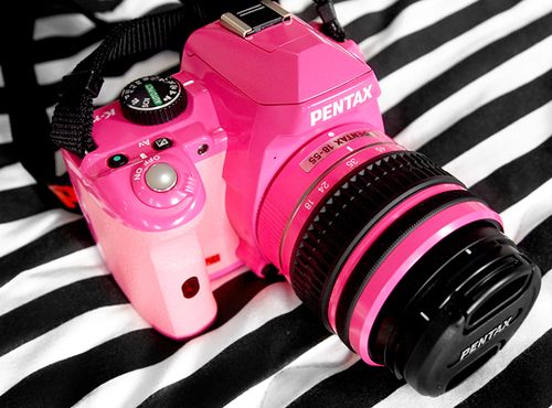 I think I SOOOOOOOO need this:  :) Google Image Result for http://www.hawaiikawaii.net/wp-content/uploads/2011/07/Pink-Pentax-camera-girly-cute.jpg