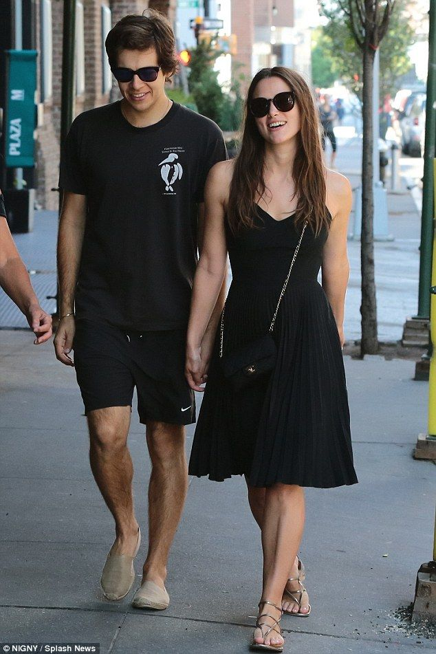 Loved-up: Colour-coordinated in black ensembles, Keira and the former Klaxons musician lau...