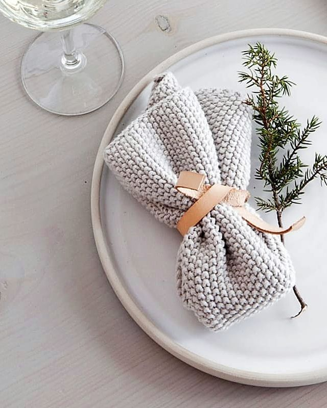 Looking for holiday table decor ideas? Minimalist plates, chunky knit napkins, scrap leather ties, and tiny trees—are chockfull of Scandinavian style.