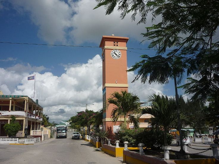 Street, park, and clock tower in Orange Walk Town, Belize.//Orange Walk Town is the fourth largest town in the nation of Belize, with a population of about 13,400
