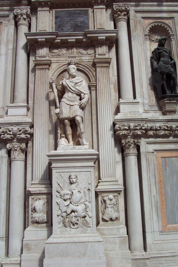 Duke of Urbino Statue -- Doges' Palace, Venice, Italy - There are more statues on the courtyard side of the Foscari Arch. This one is posed like a Roman emperor. It represents Francesco Maria I della Rovere, the Duke of Urbino, dressed in battle garb. The corresponding bas-reliefs of armor and shields, chariot wheels, and laurel wreath below are very similar to the kind of decoration we would have found in ancient Rome.