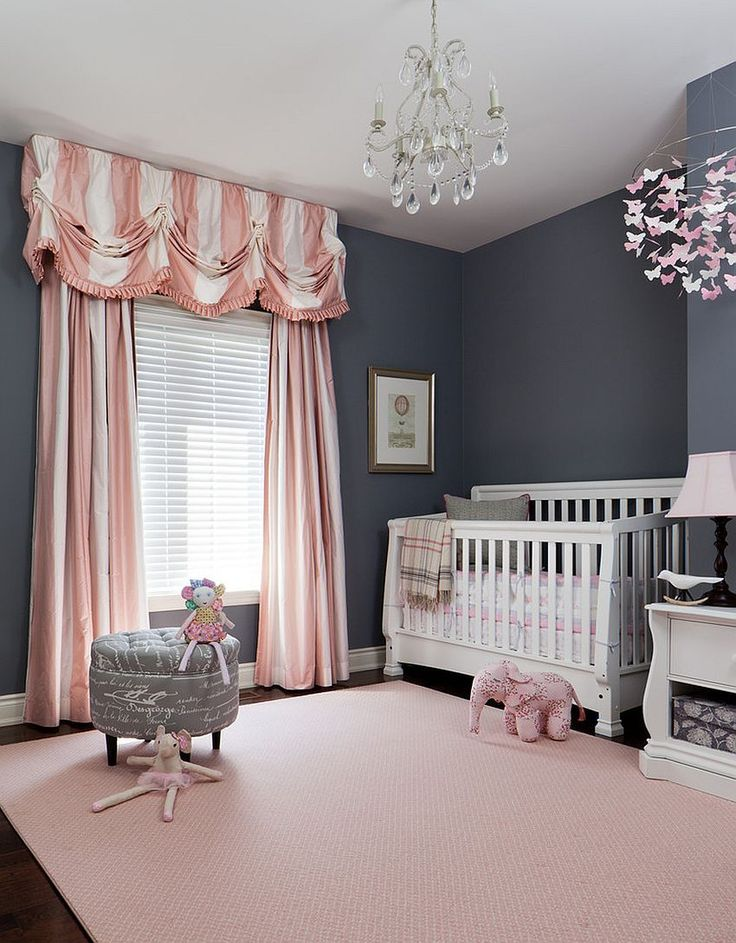 Striped drapes in pink and white enliven traditional nursery in gray [Design:  Merigo Design