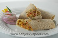 Kathi Roll: Chapattis spread with yogurt-green chutney, stuffed with a spicy paneer sabzi and rolled.