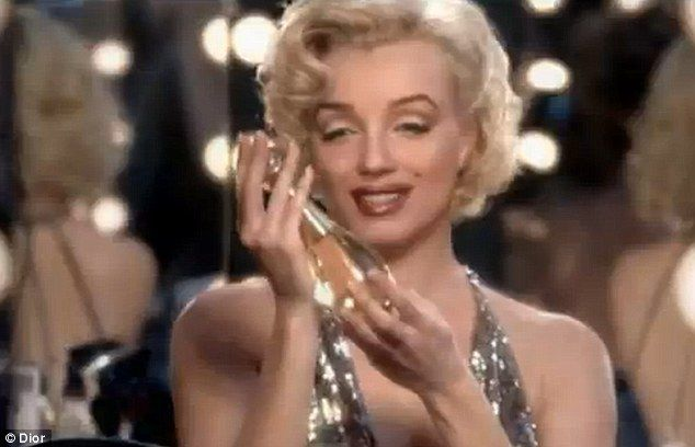 Television commercial: Some like it hot: Even Marilyn Monroe gets in on the act, cooing over the J'Adore bottle - Marilyn Monroe, Grace Kelly and Marlene Dietrich join Charlize Theron in new Dior J'Adore advert - Sept 2011