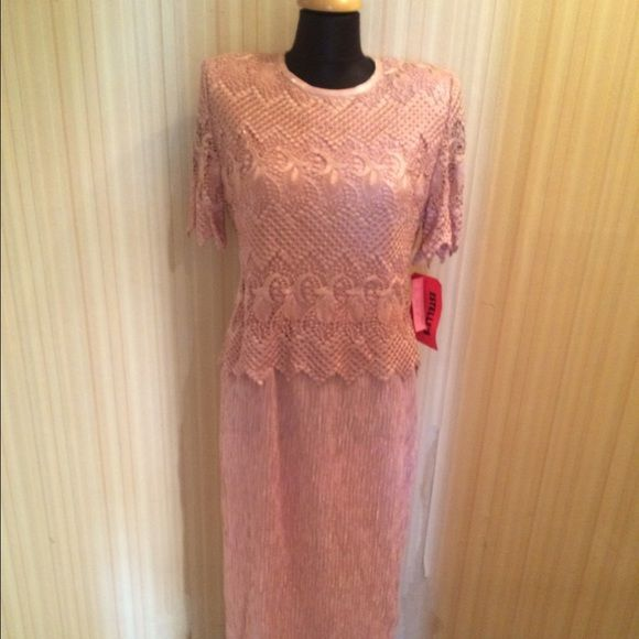 "Vintage Karen Miller Mother of Bride Column Gown Gorgeous brand new with tags from Estelle's in NYC. Karen Miller ""Mother of Bride"" evening gown dress. Mauve pink color. Beautiful lacework top with lace short sleeves with embroidered edging. Column dress with no back slit. Can be shortened. Has light shoulder pads. Column has stretch to it. Extremely well constructed. Very elegant. NWT $169 Karen Miller Dresses Maxi"