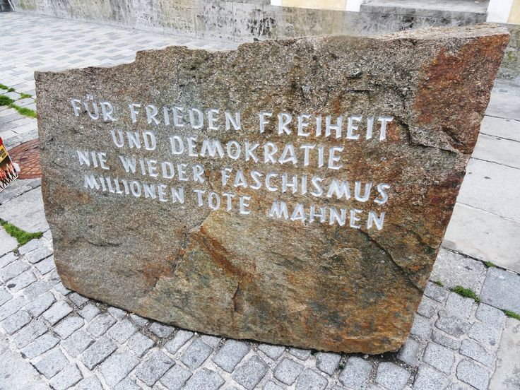 A stone plaque outside Hitler's birthplace honours the victims of fascism.