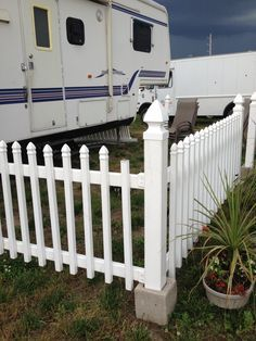 Picket fence in cinder blocks-  stable but moveable -perfect for the rv yard!
