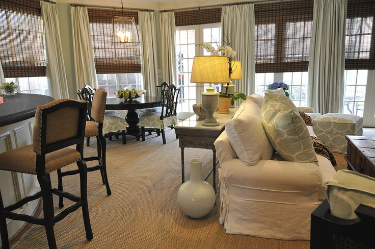 Interesting info about hanging drapes. Also love the aqua fabric on the pillows.