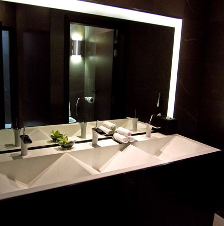 Public bathroom sinks in the spa. I love the slot drain detail in these custom sinks