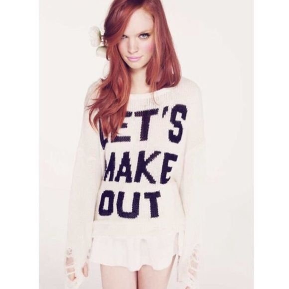 """Wildfox Couture Gold Label Lets Make Out Lennon The Wildfox Couture Let's Make Out Lennon Sweater in Clean White, worn by Jessie J, is a flirty pullover. This knitted over-sized sweater is constructed from a wool blend and features a """"Let's Make Out"""" printed design on the front with distressing throughout.Color: Clean White Fabric: 56% Acrylic / 34% Nylon /10% Wool Approx. Length from Shoulder to Hem: 26"""" (Measurements based off of size S). No trades Wildfox Sweaters"""