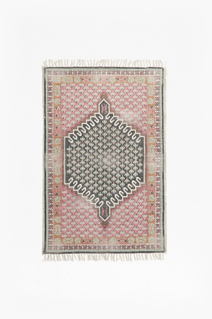 <ul> <li> Screen-printed rug</li> <li> Block floral design</li> <li> Frayed edges</li> <li> Available to purchase in larger size</li> <li> <strong>120cm x 180 cm</strong></li> </ul>  <strong>Please note: </strong>This piece was individually hand dyed using a special process, making each piece original and one of a kind. No two pieces are exactly alike. Any ...