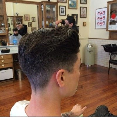 short cut with blended definition at graduation from #1 clipper at base to a scissor taper