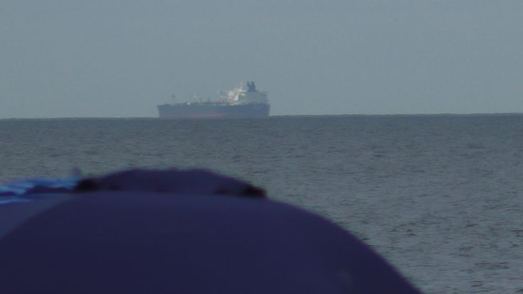 Tanker ship on the horizon just off from Lewes, Delaware. Photo by Kathy Fite Simon 6/25/17