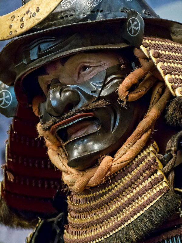 Closeup of Samurai wearing Tachidō Armor Early Edo period 17th century CE Japan iron, gold, lacing, bear fur, silver, wood
