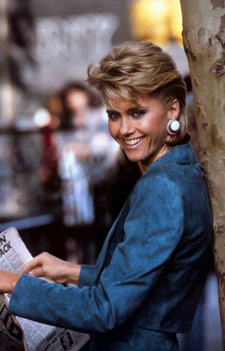 olivia newton-john looking cute with her 1980s short hairdo