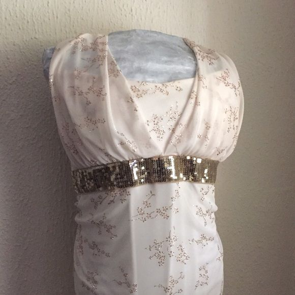 Cream Formal Dress with Gold Floral Detail A simple dress with a little sparkle for a memorable night out! Great for homecoming or prom! Worn once this dress has a few small spots and a little wear on the glitter as pictured. None noticable during wear! Taboo Dresses Prom