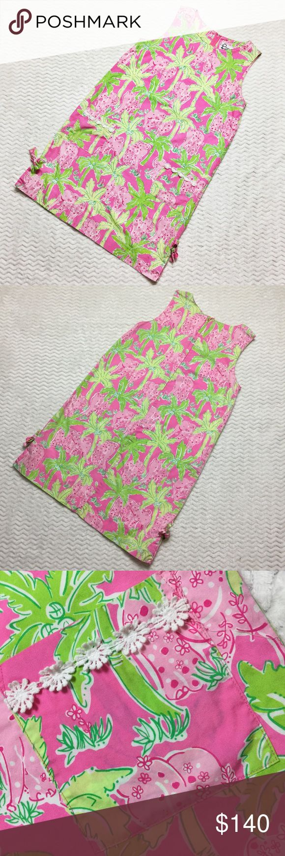"❌SOLD❌ Lilly Pulitzer Taboo With Elephants dress It doesn't get more classic than this Lilly Pulitzer shift! This is a sleeveless dress with front patch pockets featuring crochet trim, tie bows at hem and comfortable relaxed fit. The print is simply amazing and one of Lilly's iconic classics--Taboo with Elephants, showcasing playful pink elephants and vibrant green palms on a dark hot pink background. Lined. Size 12. 36"" length from shoulder to hem, 19"" bust (flat across), 22.5"" waist/hip…"