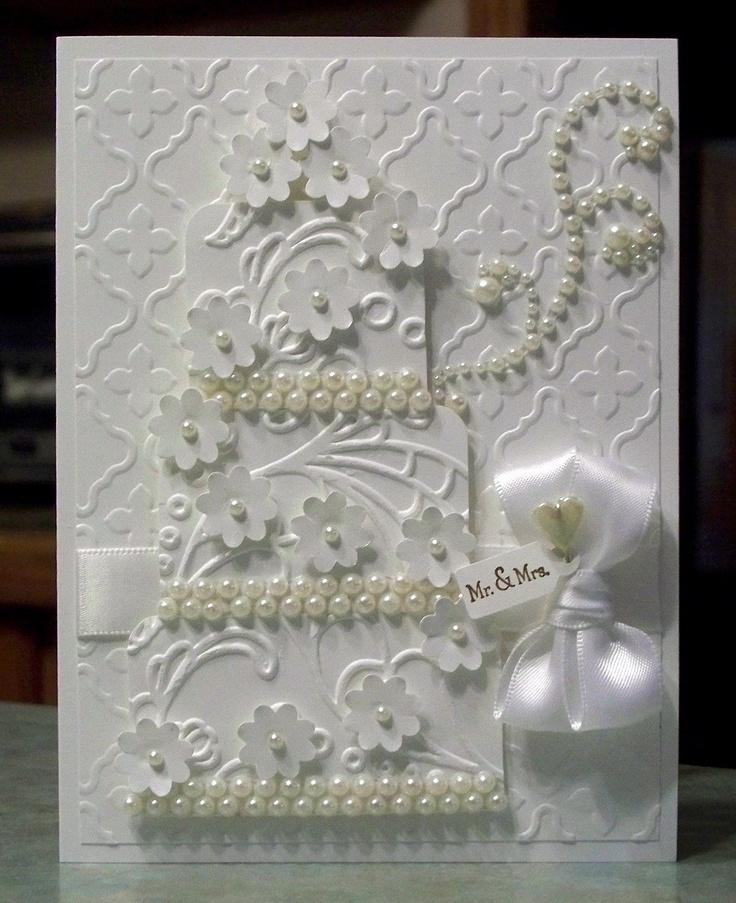 Stunning Wedding Card, White on White Embossed Three Tier Cake. $6.00, via Etsy.  WhimsyArtCards