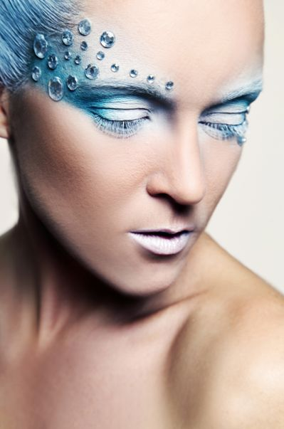 Crystals accent an icy blue and white fantasy make-up look.