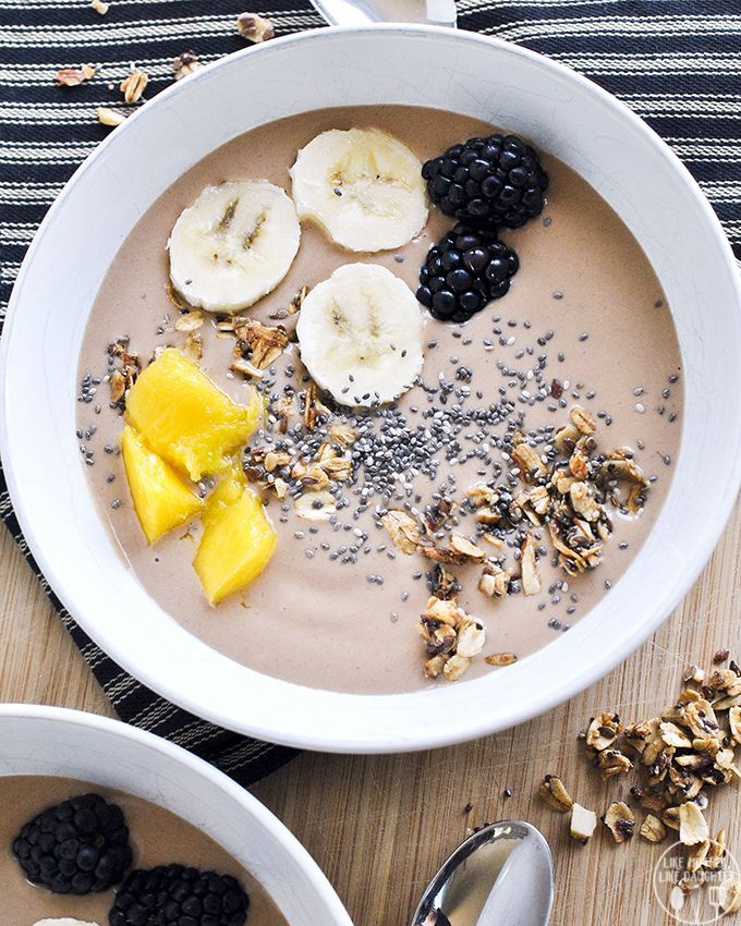 Chunky Monkey Smoothie Bowl, flavor combination of chocolate, peanut butter, and bananas, with assorted fruits and granola or nuts or chia seeds toppings.