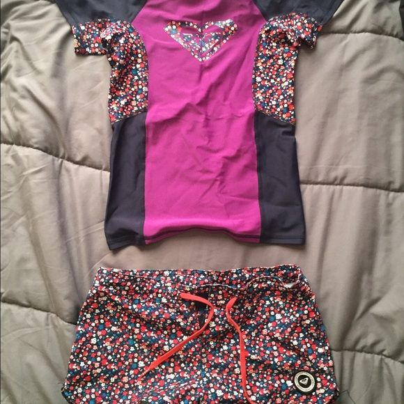 ROXY surf rash guard shirt & shorts this ROXY youth girls rash guard surf set comes with the rash guard shirt and surf shorts! The shorts and shirt are a girl youth large! only wore once! let me know if you have any questions xx Roxy Swim Bikinis