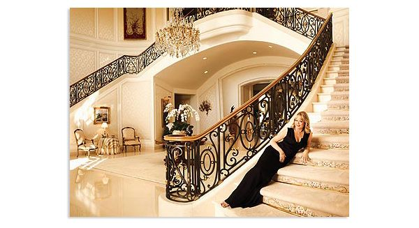 I don't need the woman lying on the stairs, but I like the dual staircases with wrought-iron railings as the main color in a cream setting.