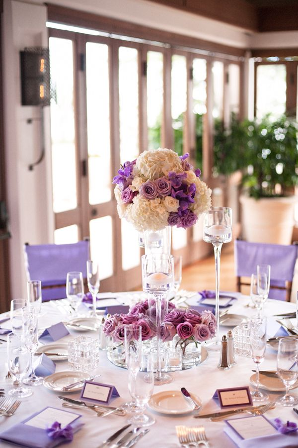 Color scheme lavender and purple table setting with floral centerpiece - Honolulu destination wedding photo by top Hawaiian wedding photographer Derek Wong