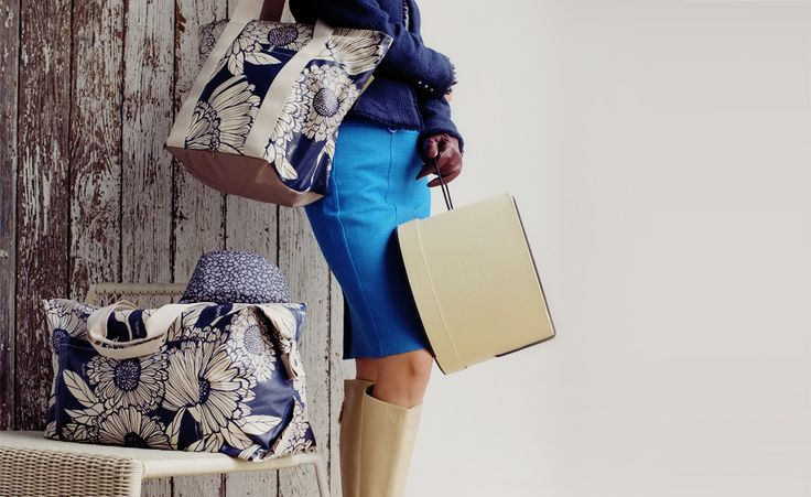 Marigold Premier Collection in Blue Note. Featuring the Cruise Bag and the City Tote.