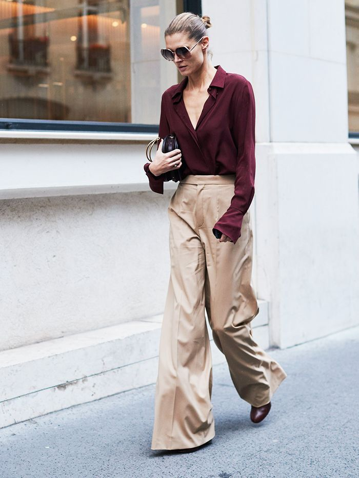 Autumn Outfit Idea. Wine colored v neck blouse styled with high waisted wide legged beige pants