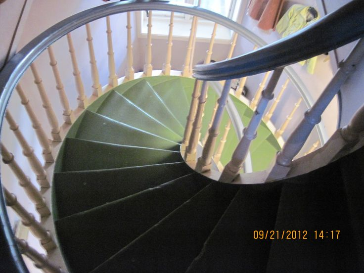 Another section of the winding spiral wooden staircase, looking down from a further floor, walking upwards...it´s getting smaller....
