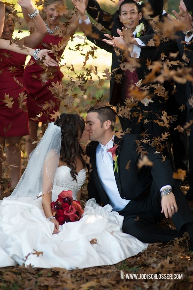 GREAT Idea to capture the brides maids and grooms men but i dont like the idea of sitting on the ground in the dress. However I might get a pic taken with the leaves being thrown