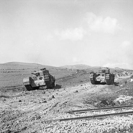 Churchill tanks move up on 28 February 1943, to meet the Southern Horn attack by Korpsgruppe Weber during Operation Ochsenkopf in Tunisia.