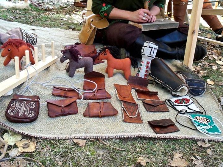"""HISTORICAL Early medieval leather """"wallets"""". Reconstructions crafted using medieval tools and  materials, impregnated with wax/fat mixture. Textile crafts made by my mother."""