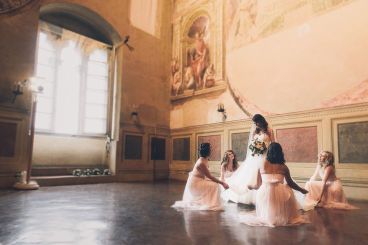 Intimate Wedding in Siena at Palazzo Pubblico. Bride and bridesmaids wait to walk down the aisle. Photo by Gabriele Fani Destination wedding photographer in Tuscany.  #wedding #weddingday #weddingitaly #weddingphotographer #lovestory #weddingstories #weddingsiena #bride #friendship #bridesmaids #iTellLoveStoriesWithPassionLoveAndJoy #gabrielefaniphotographer