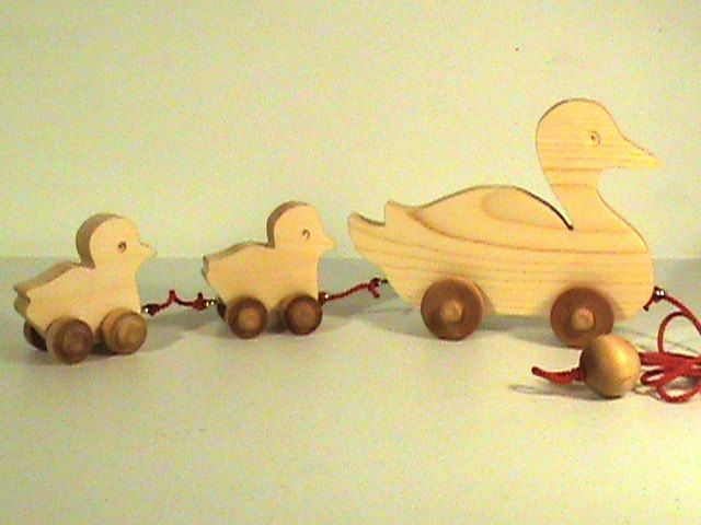 Wooden Mama Duck and Babies Pull Toy - All Natural - Unpainted - Wiggle As They Roll - Eco Friendly Toy. $29.95, via Etsy.