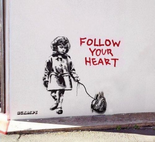 Banksy combines gore (the authentic heart) with innocence (the sweet little girl). I really like Banksy's black and white, dripping paint style.