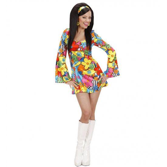 Hippie jurkje met bloemen voor dames. Leuk vrolijk hippie jurkje met bloemenprint in de kleuren geel, rood, blauw, groen en oranje. Het bloemen jurkje heeft lange uitlopende mouwen, een smalle taille en is uitlopend tot aan het bovenbeen. Perfect jurkje om in de seventies stemming te komen!