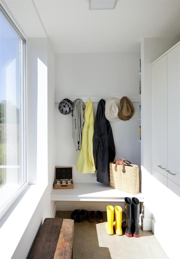 'The small mud room with a built-in bench helps the family stay organized and keeps the house free of clutter.'  Architect: ZeroEnergy Design, Boston  Builder: Aedi Construction, Waltham, Mass.