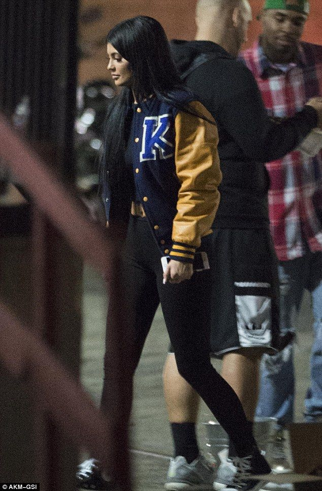 Video star? The 18-year-old star of KUWTK wore a personalized varsity jacket with black leggings