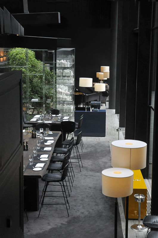 Conservatorium Hotel Amsterdam...table looks like crate and barrel love edge dining table stained darker. Not a bad idea.