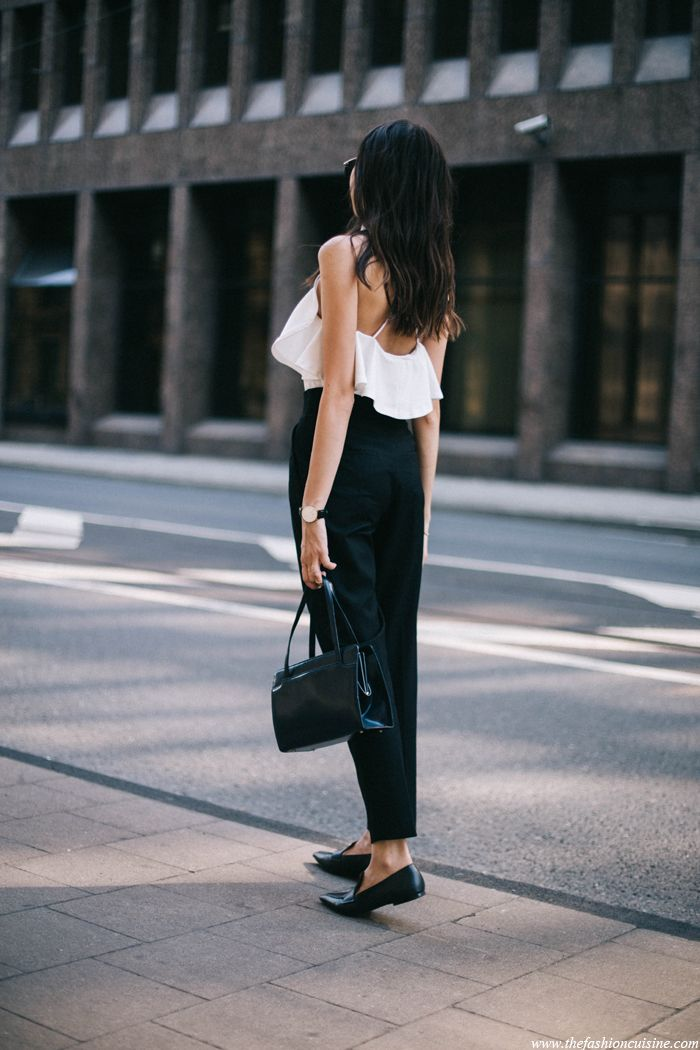 fashion blogger wearing monochrome outfit, slim girl in white crossback top and high waisted trousers